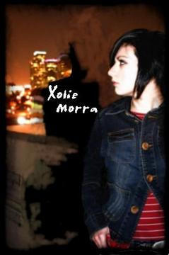 Uncovered, by Xolie Morra & The Strange Kind on OurStage